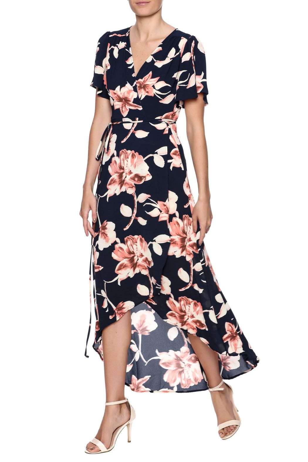 db2dd244ecd7 Navy blue floral printed wrap dress with short sleeves v-neckline high low  front andadjustable side ties. Navy Floral Wrap Dress by Peppermint.