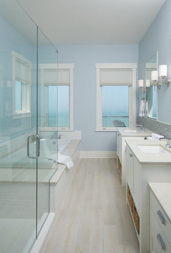 The Master Bathroom Tile Simulates Hardwood Floor In Main Area Of House