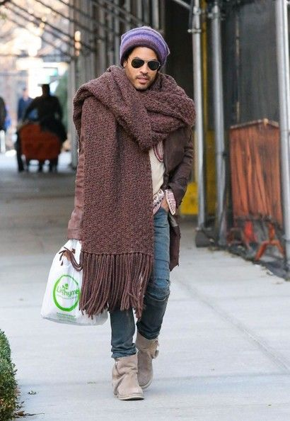 08129e39345 only a man like lenny kravitz can sport a very big scarf with jeans tucked  in those suede mocassin-like half boots and look so cool.