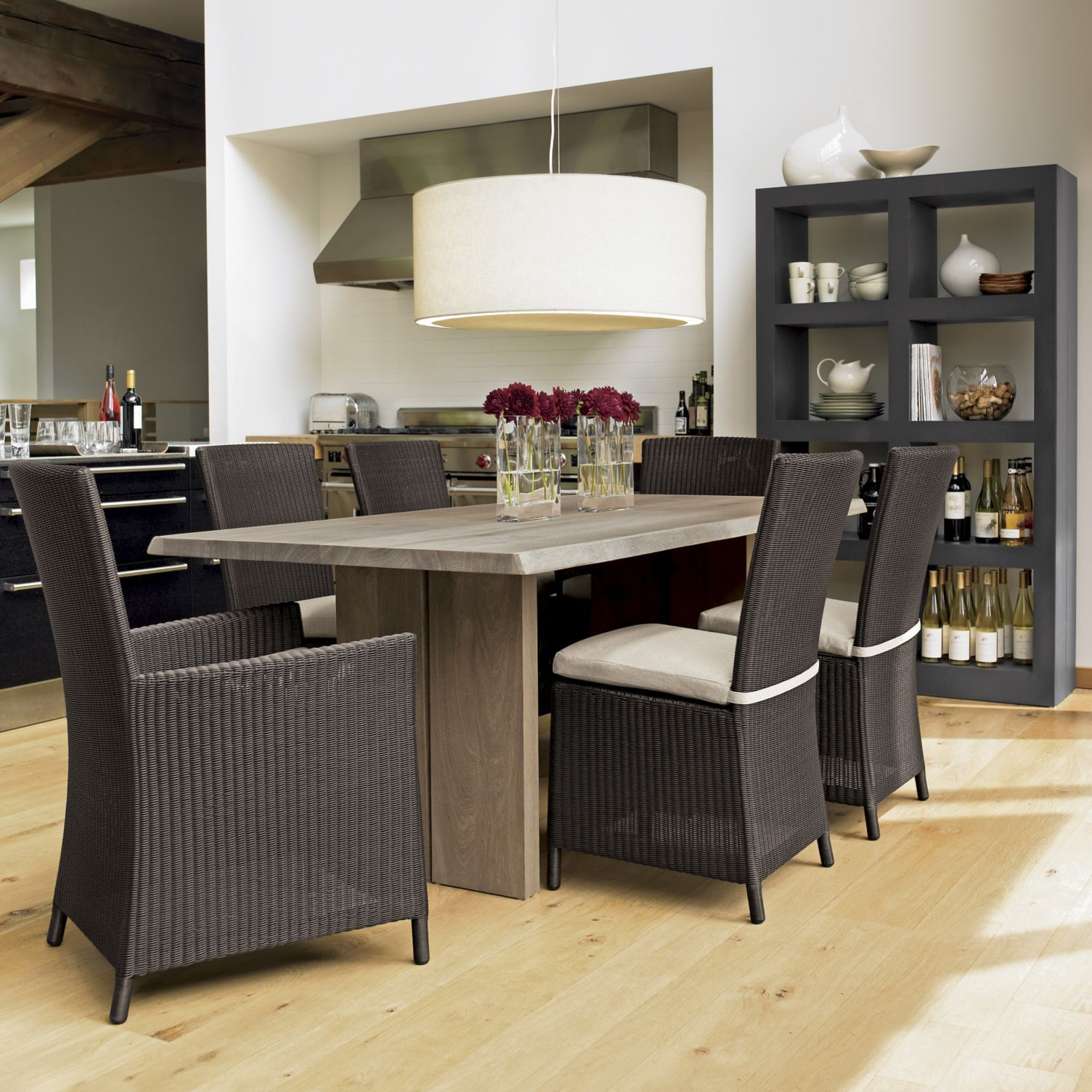Dakota from crate and barrel with dark chairs and sideboard dining