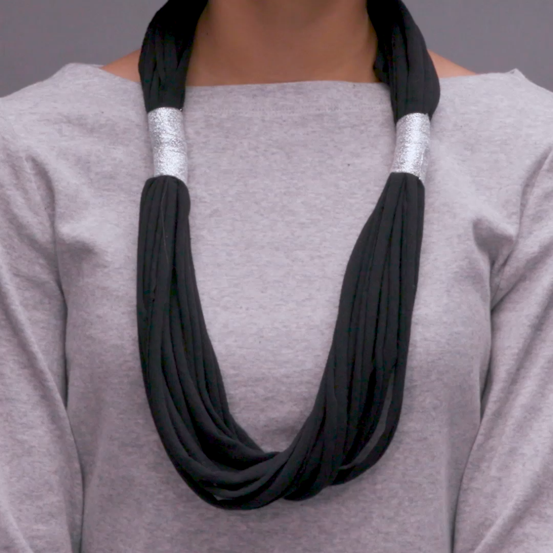 Everybody's got that drawer full of old t-shirts that never see the light of day. But we found a fun and fashionable way to give them a new life! Here's how we turned a boring old T-shirt into a show-stopping statement necklace.