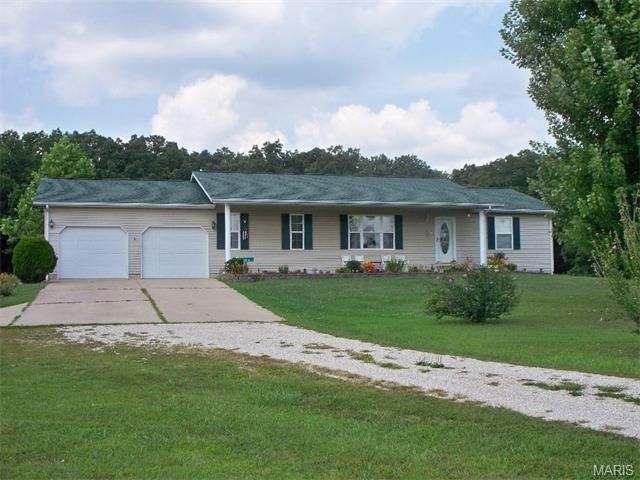 Very pretty home on 30 acres m/l. Private setting. Open floor plan with porcelain floors in kitchen and utility room. Home has split bedroom plan. Lower level is open and has kitchenette for in-laws quarters or extra family space. Lower level has Gas vent less heat. Has a 100 gal. gas tank which is owned by owner for the wall unit. Lots of extra storage area. There is an above ground pool for summer play. Guys, check out the 24 by 24 detached garage for your extra toys in Rolla MO