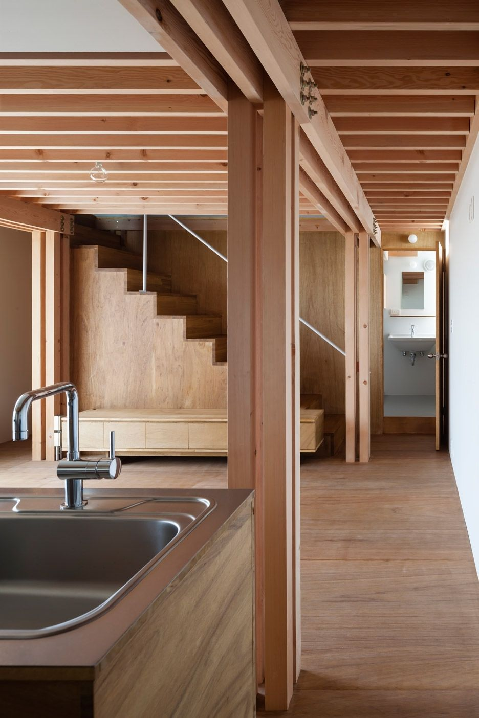 This japanese house features four wooden columns arranged in a square to support the rest of