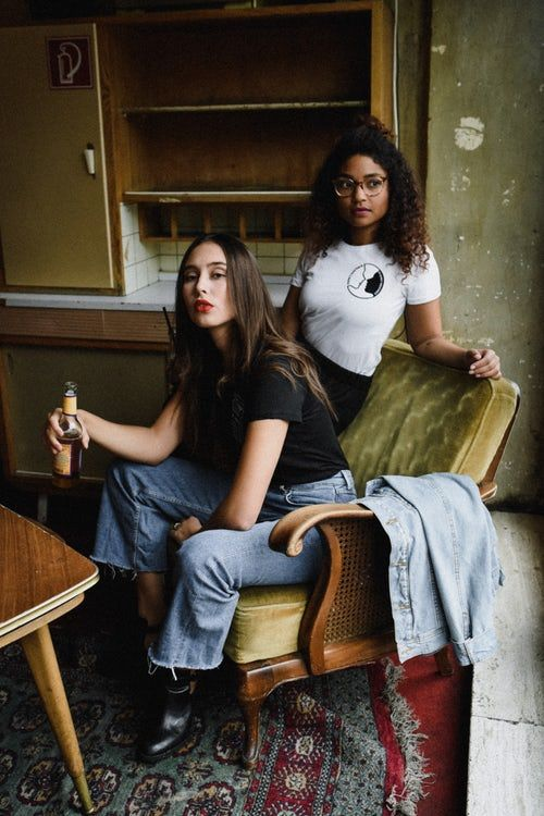Woman Holding Bottle Sitting On Brown Wooden Armchair Woman Sitting On Arm Chair In 2018 Pinterest Relationship Women And Too Cool For School