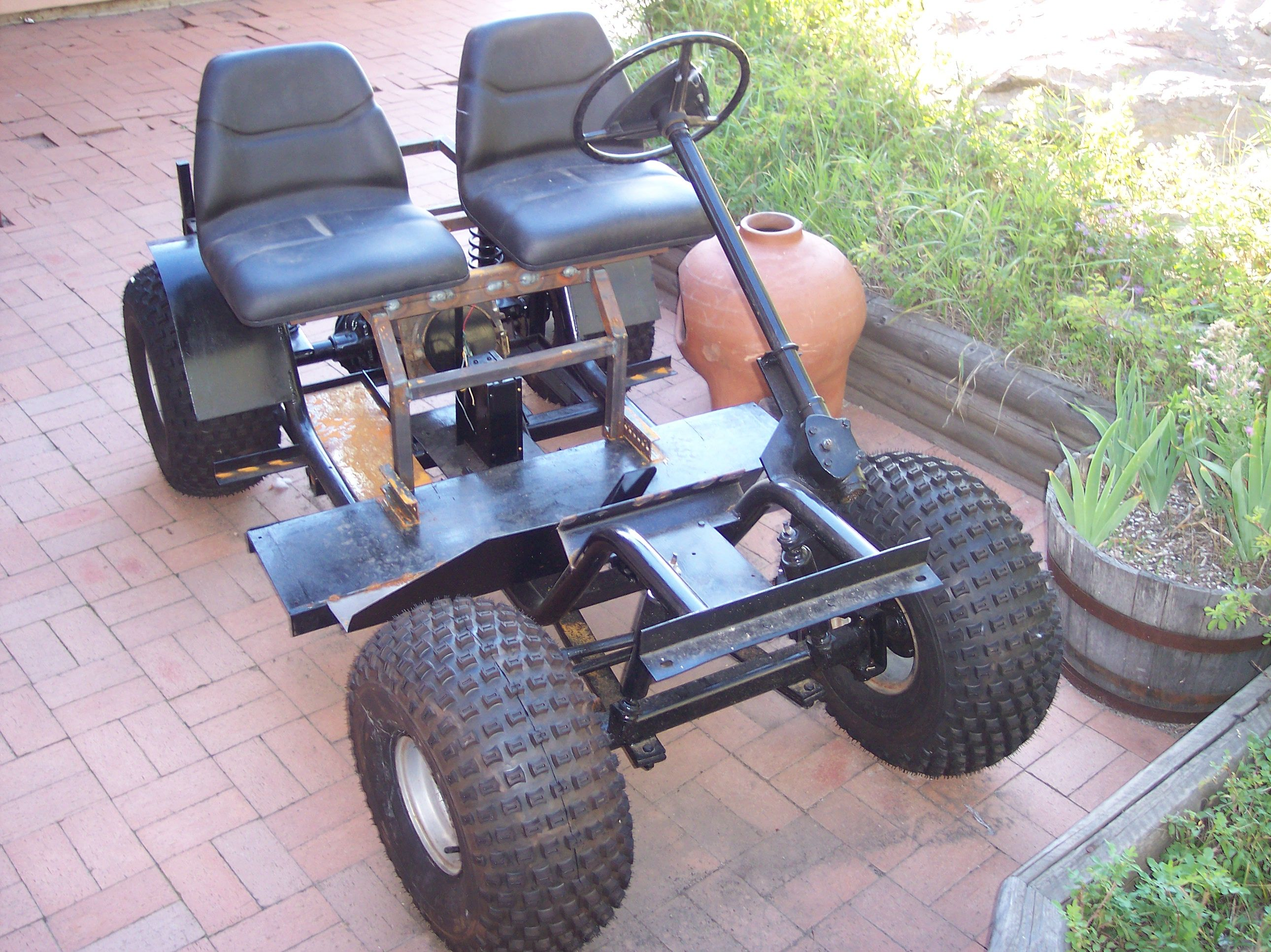 The beginnings of a golf cart modified to an off road