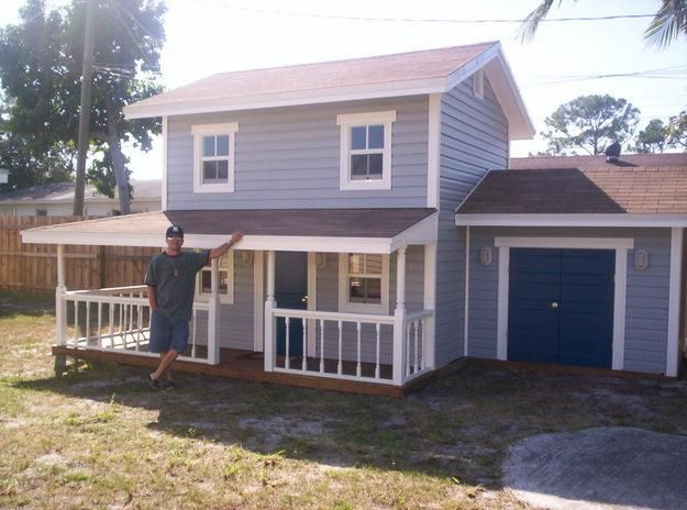This Playhouse Is Huge Even Has A Garage For The Power Wheel Awesome Play Houses Kids Playhouse Build A Playhouse