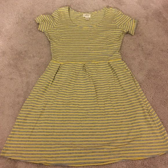 Yellow gray dress New . It's in really great condition.. Yellow and gray strips pocket on the side of the dress. Upper body is fitted... Levi's Dresses Asymmetrical