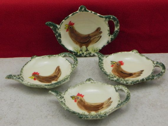 This is a set of 4 tea bag holders.They are approximately 3 1/4 X 4 1/4 hand painted in our Chicken design and sponged green on the outer edge in our own under glaze. This makes a great gift. They can be used as a tea bag holder, a place to put your ring, spoon, brillo pad or can be used as a lollipop or gum catcher. We cast them in stoneware slip, hand painted in our own food safe under glaze no two are exactly alike since they are hand painted, then they are fired and glazed in ou...