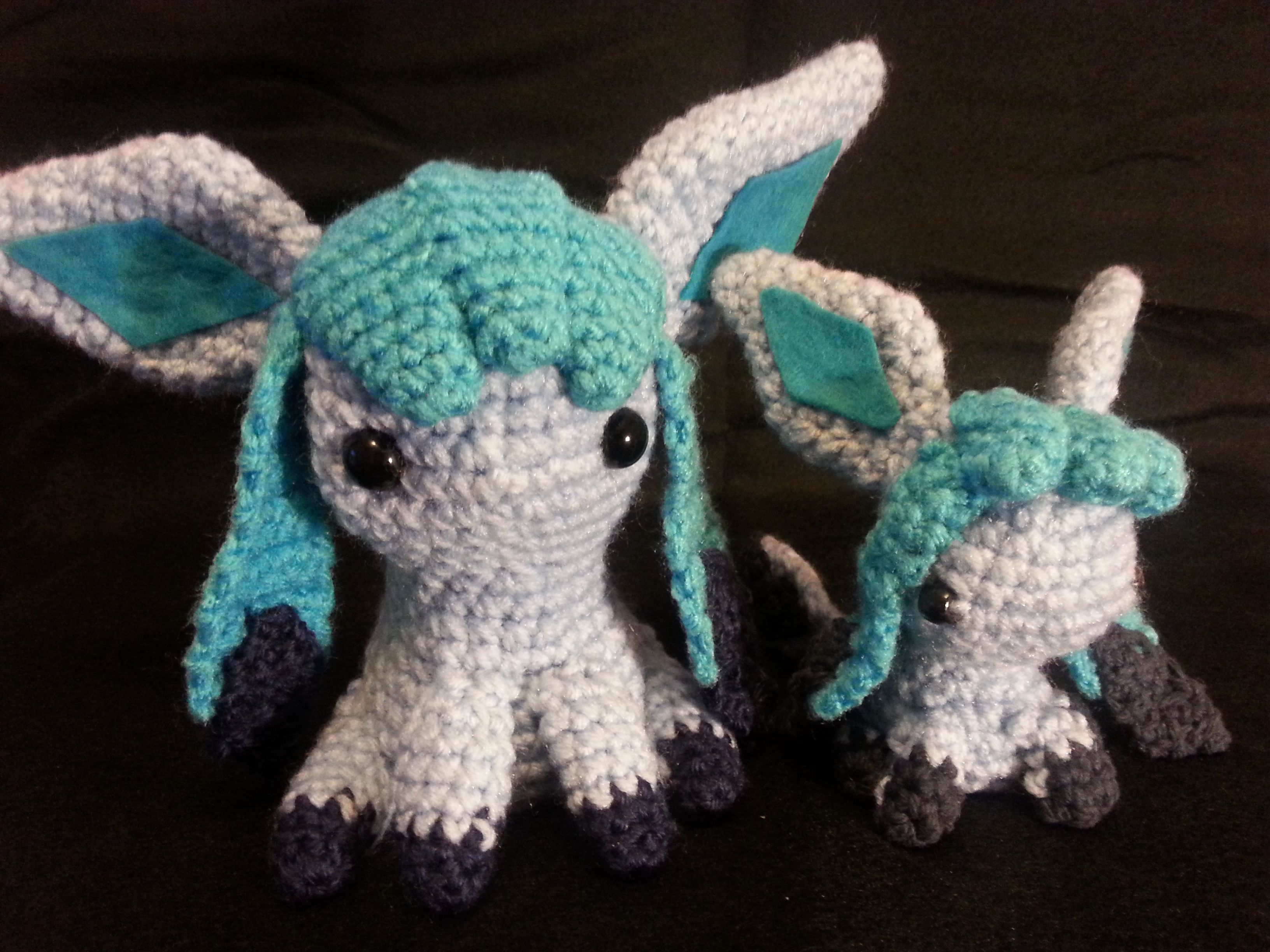 Mini and normal sized Glaceon amigurumi! These guys were a nightmare with all the little added details but I think they turned out great.