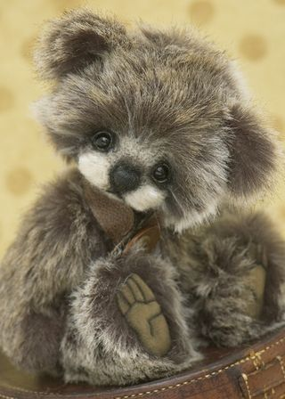 Timberley Bear, a sweet baby cub made from realistic faux fur. Has a needle felted muzzle which adds to his sweet expression.