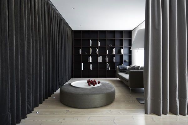 Theatrical Apartment Design With Drapes As Space Dividers