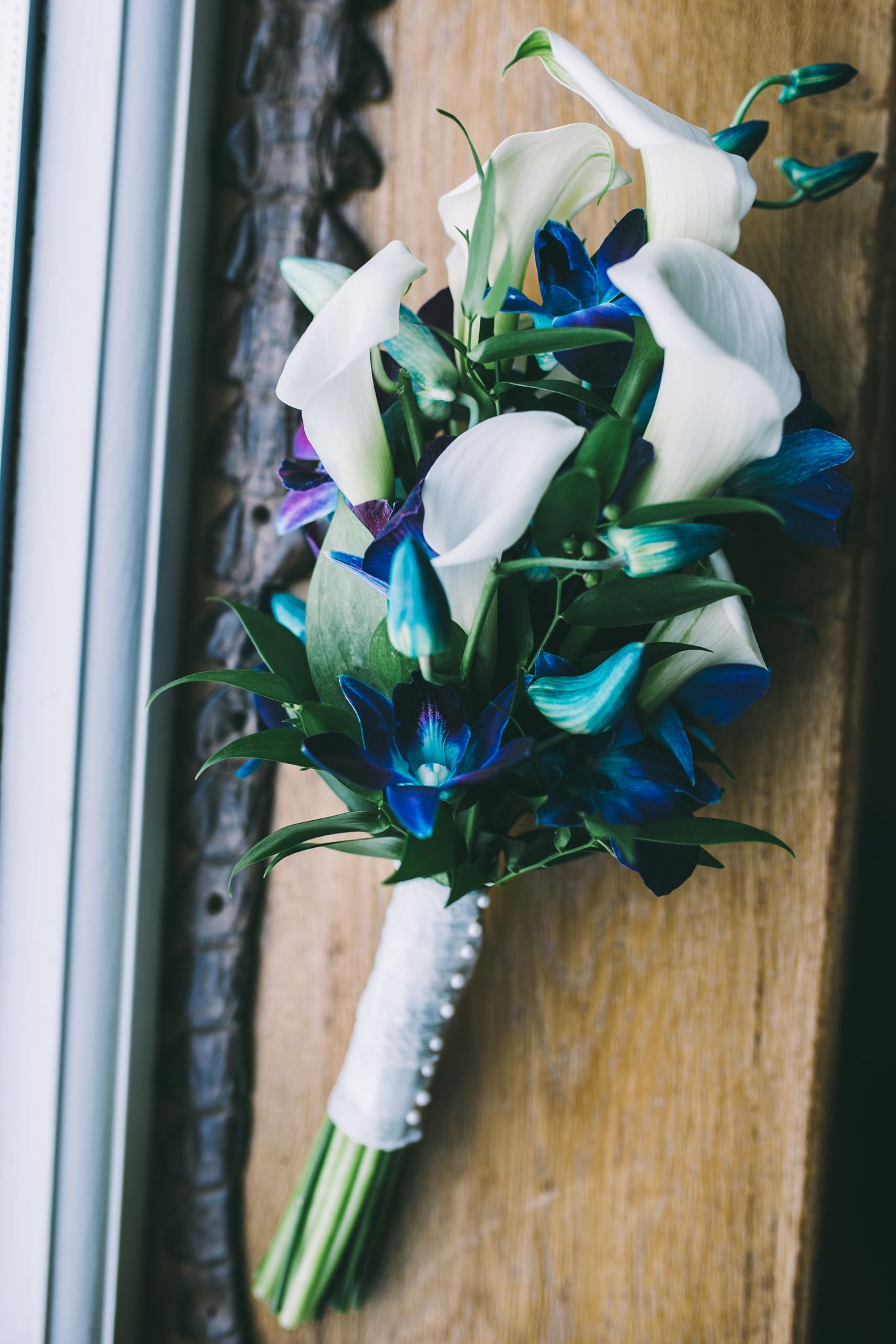 Ivory calla and galaxy blue orchid wedding bouquet wedding