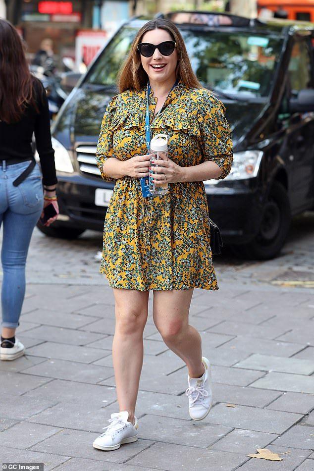 Kelly Brook looks radiant in a ditsy print mini dress in