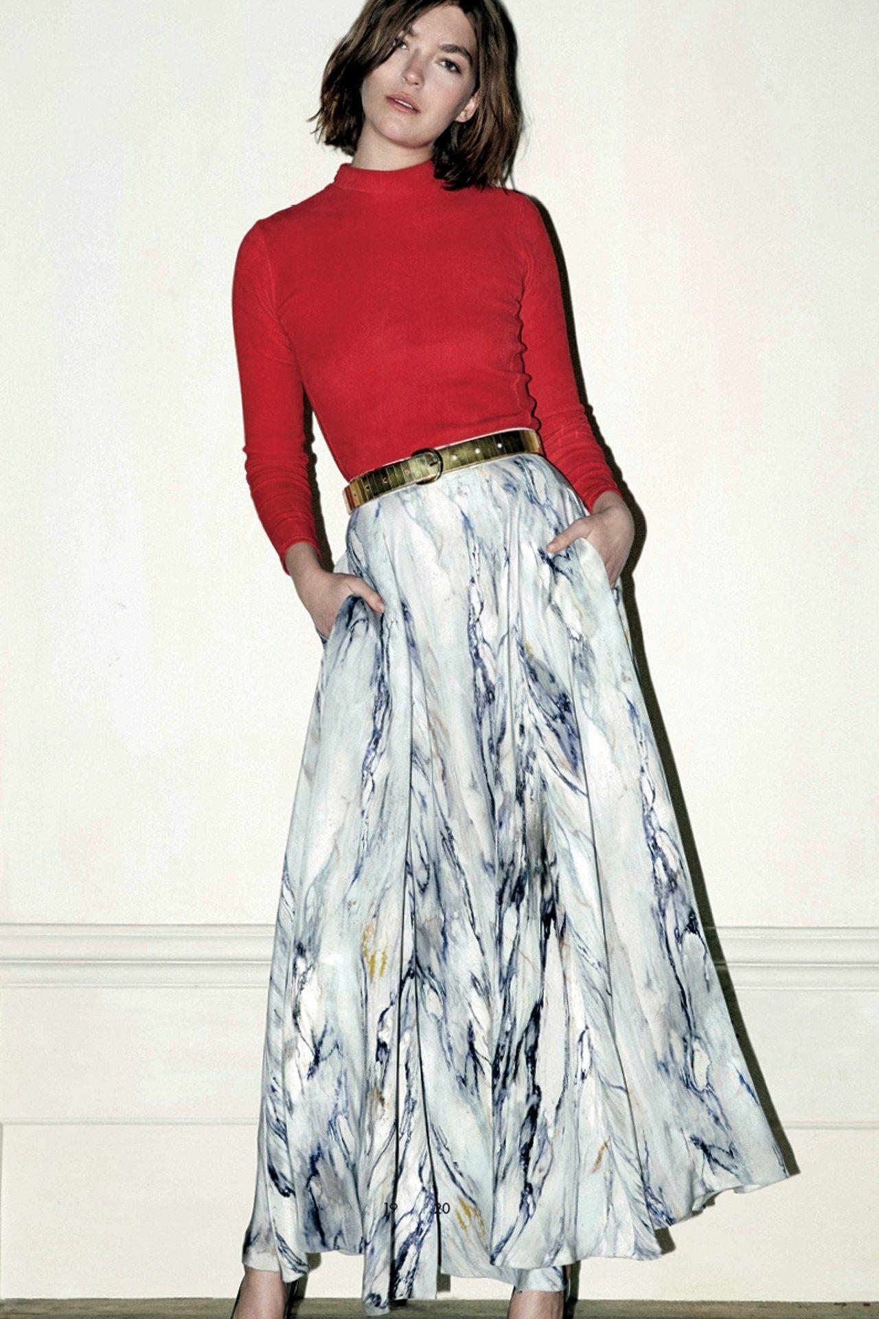 White marble print full maxi skirt, red long sleeve blouse, gold belt. Trager Delaney, 2013.