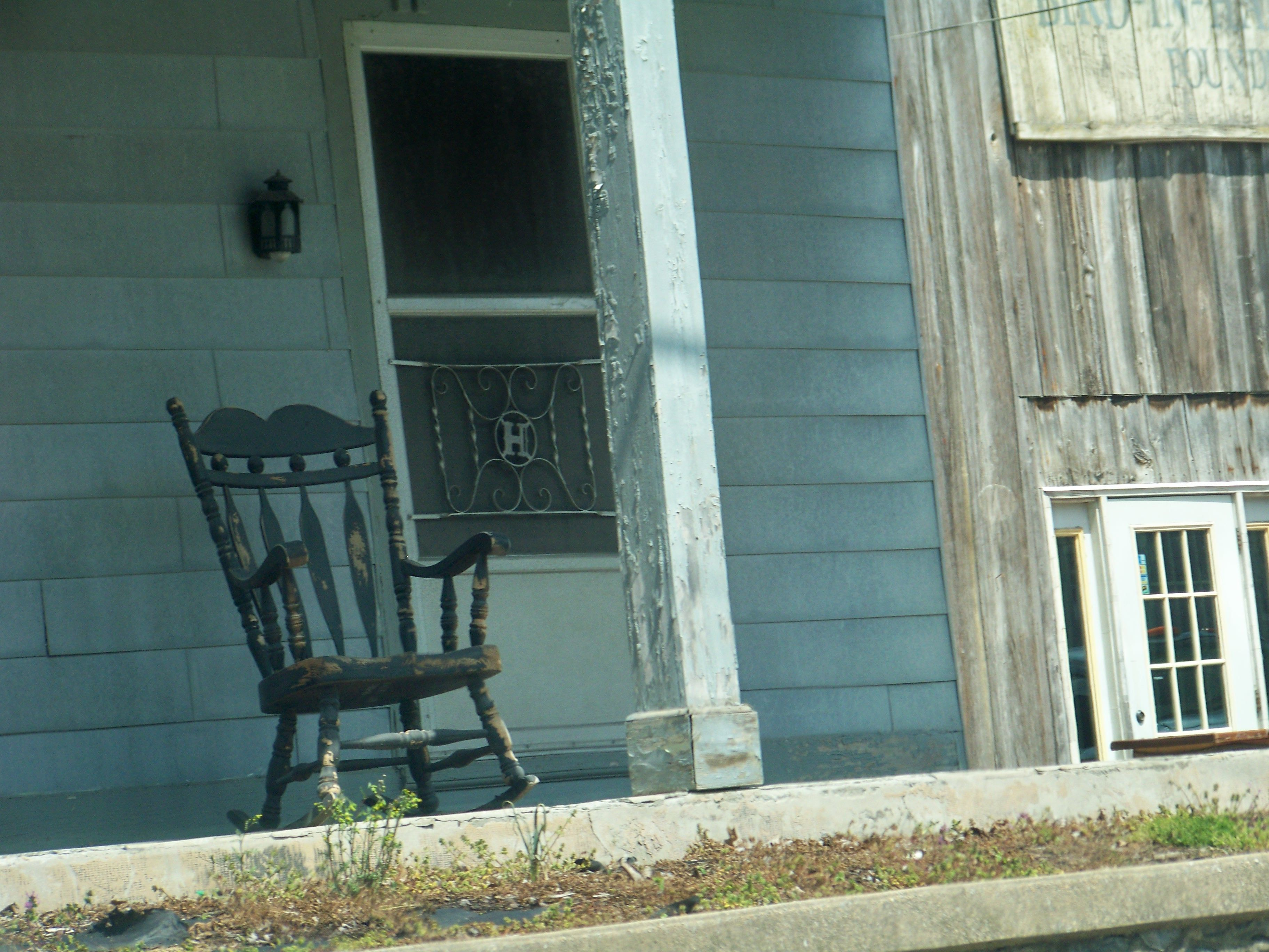 an old rocking chair on an old front porch