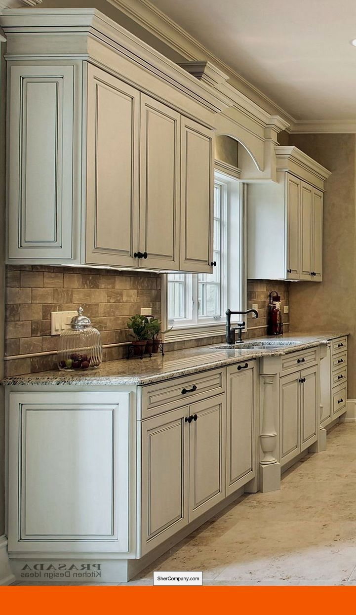 White cabinets and slate appliances and pics of whitewashed wood