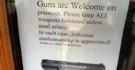 "Tennessee  restaurant owner posts ""Guns are Welcome on Premise"" sign and business booms.  She posted her sign after another restaurant posted a ""No Guns on Premise"" sign and was robbed at gun point 2 days later."