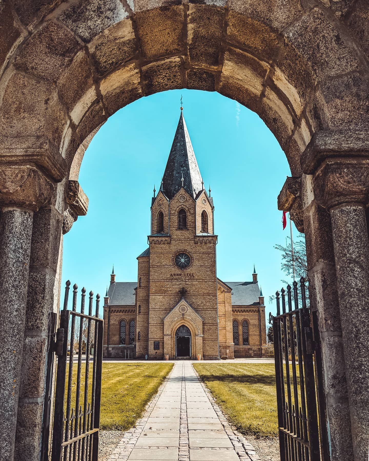 Framed...⁠ ----⁠ ⁠...church of Christiansfeld in Denmark.⁠ ⁠⁠ Here is the second shot from my little 3 part Christiansfeld series.  Nothing else to say 😉⁠ Have a great Sunday everyone!⁠ ⁠ ⁠Please support my work!⁠ ⁠ ⁠⁠🌟Save this post for later as inspiration🌟⁠ 💥Leave a like & a comment 💥⁠ 🗣️Recommend my profile to your friends🗣️⁠ ⁠ -------------------⁠ ⁠ helgaandheiniontour.com⁠ ⁠ -------------------⁠ ⁠ ✖Follow @helga.and.heini.on.tour✖⁣⠀⠀⁠ ✖Follow @igershamburg ✖⁣⠀⁠ ✖Follow @judijumper ✖