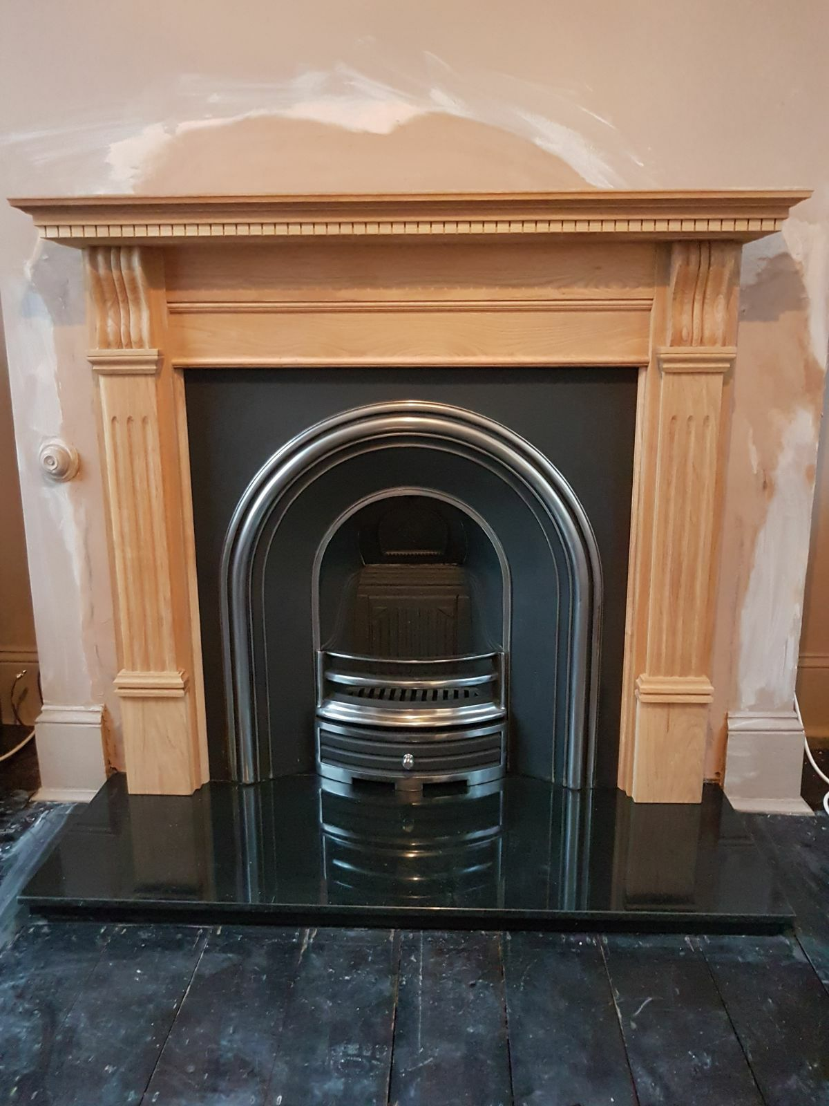 jubilee black cast iron with a large corbel surround sitting on a