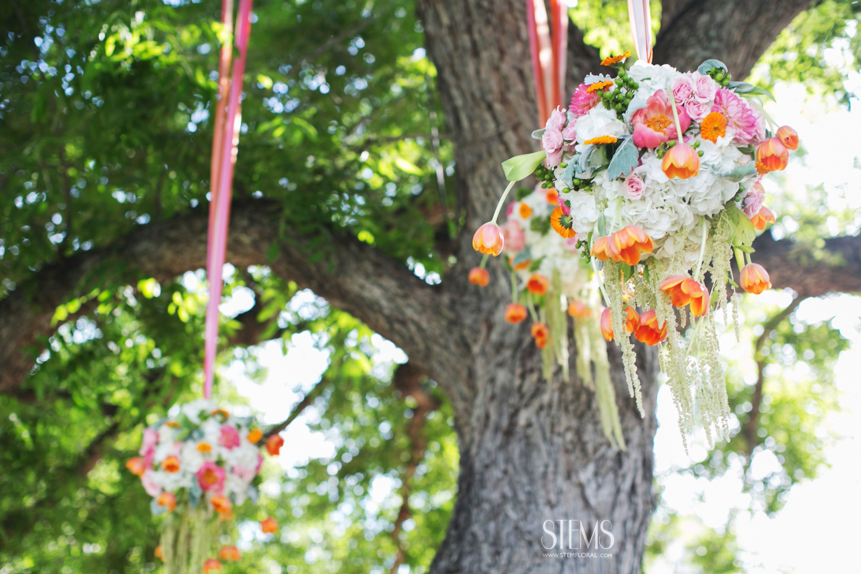 Wedding decorations hanging from trees  emfloral I photome I rrmansion Barr