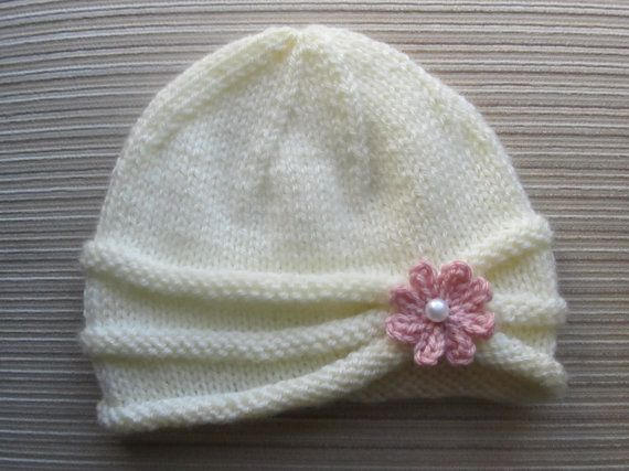 Photo of Knitting Pattern Girls Hat with Rolled Brim and a Flower in sizes 6-9 months and 2-4 years #86