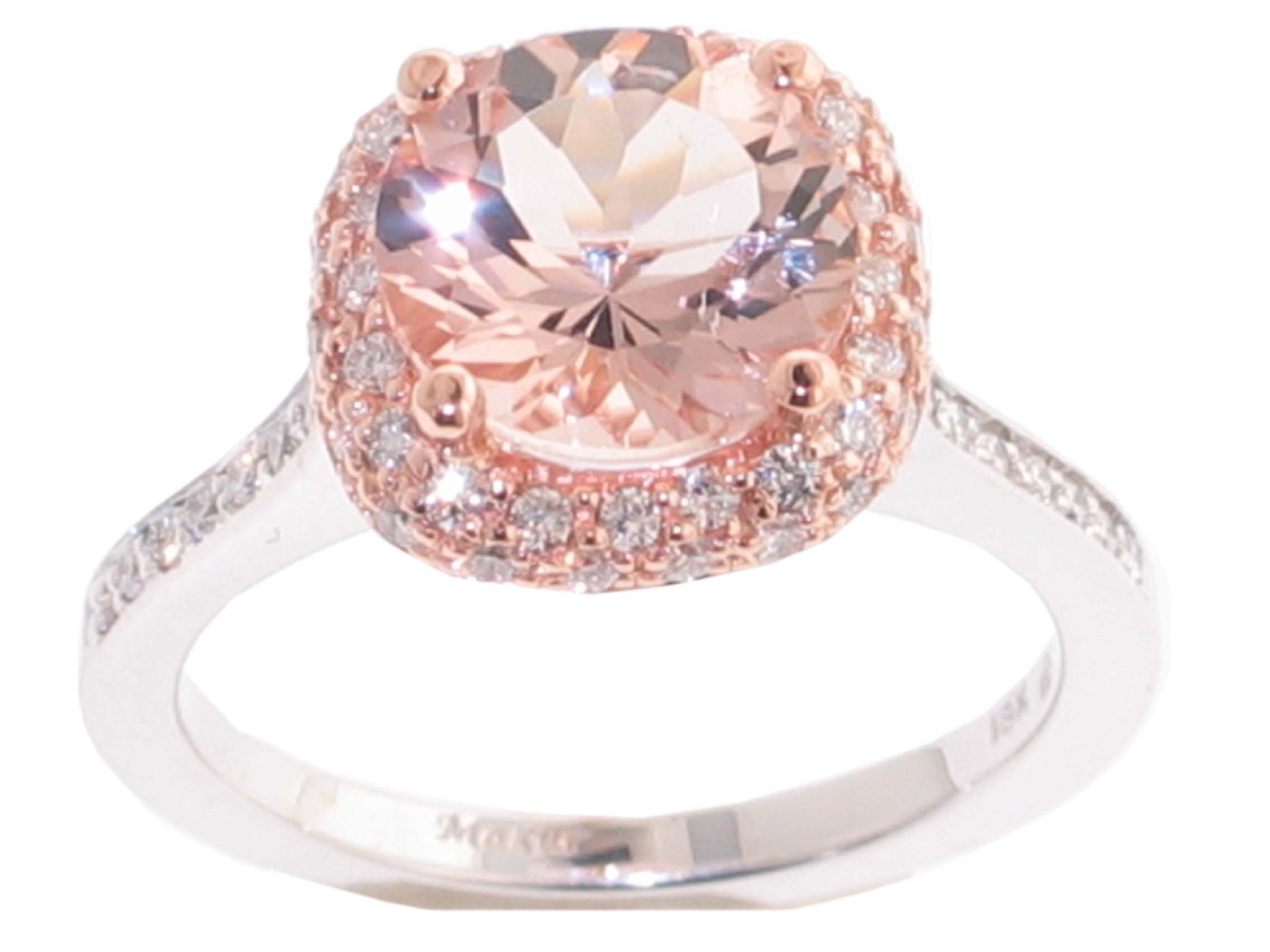 This beautiful ring is set with a Morganite center and creates a ...