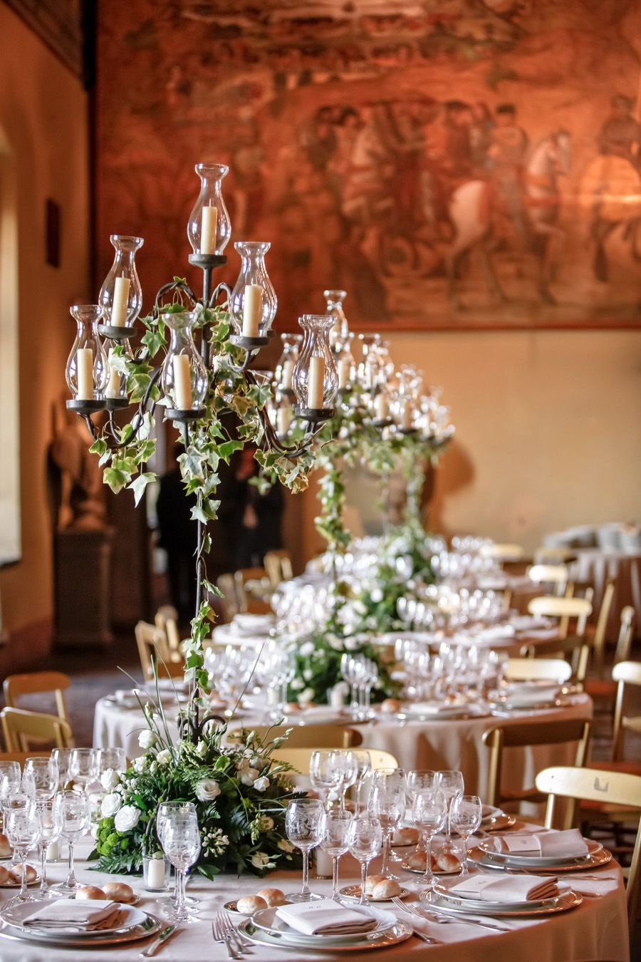 Candelabra centerpieces with ivy … pinteres…