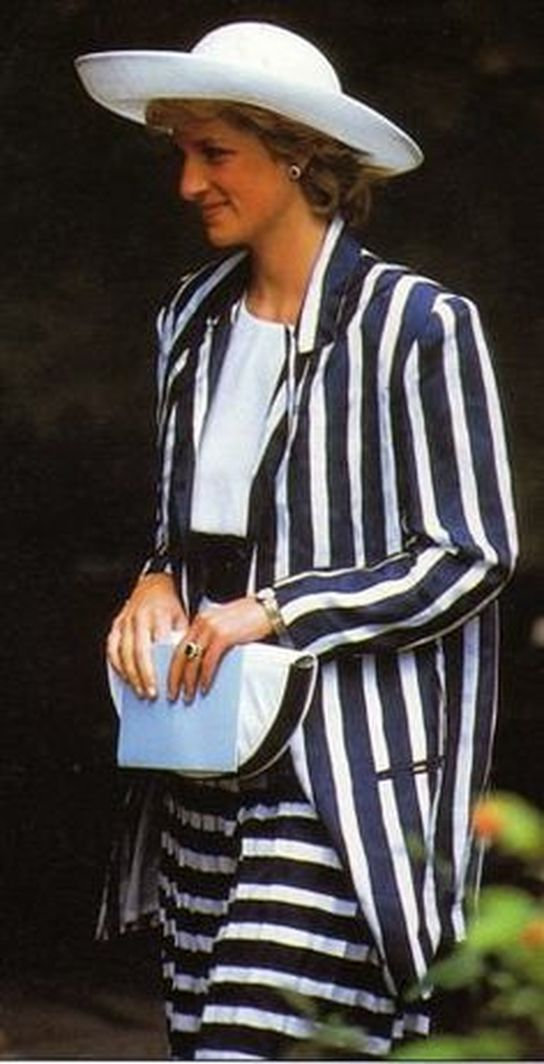 On Thursday July 9th in 1987, Princess Diana carried out two public engagements during a visit to the county of Cambridgeshire.  Her visit was to the Royal Air Force Hospital at Ely, which had recently been renamed The Princess of Wales Hospital in her honour.  Diana wore a navy and white striped two-piece suit by designer Roland Klein, worn with a large wide brimmed hat by Philip Somerville and navy and white two-tone leather court shoes.