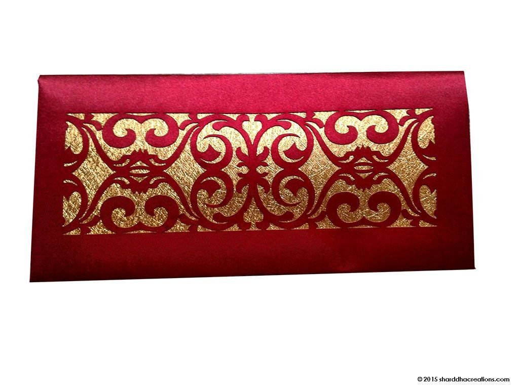 #Shagun #MoneyEnvelope in Maroon Satin Cloth with Laser Cut Design - Shining money envelope in berry red satin. Envelope has a laser cut window with golden shimmering background. #GiftEnvelopes #LotusCardStudio
