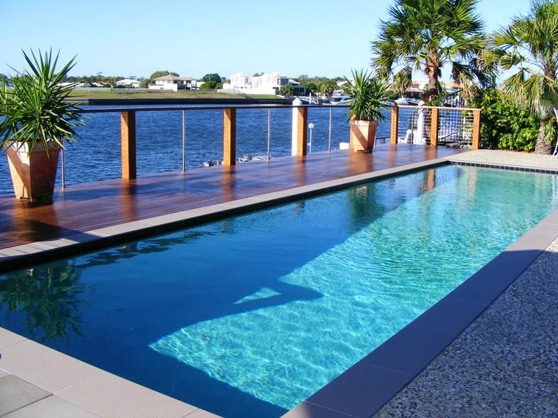 Glass Pool Fencing I Would Like It With White Wood Modern Pools Swimming Pool Landscaping Swimming Pool Photos
