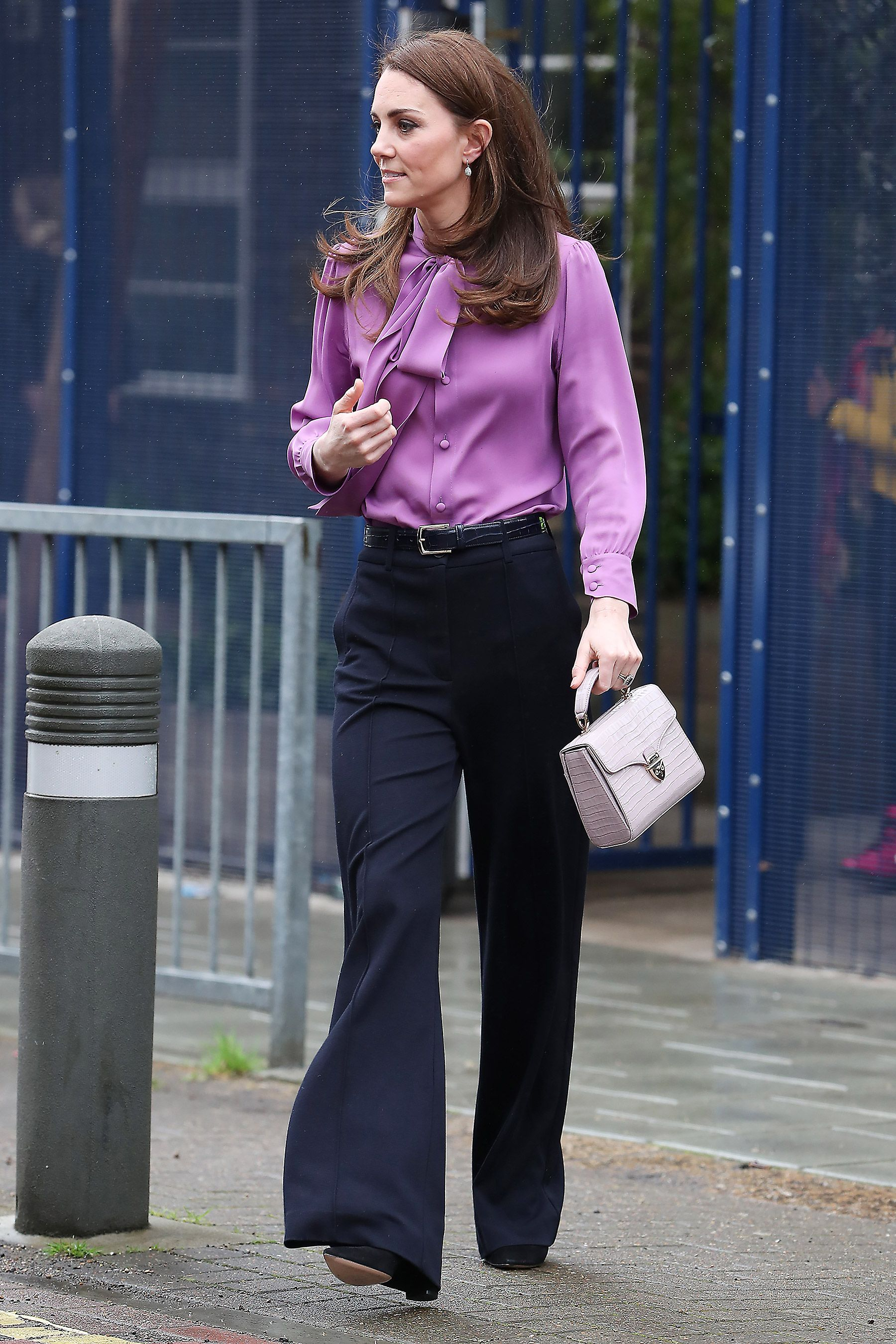 31daf252ef5 Did Kate Middleton Make a Major Fashion Statement by Wearing Her Purple  Gucci Blouse Backwards?