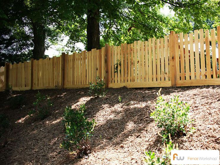 Traditional Picket Fence Design With A Twist We Love The Alternating Picket Height Fences Picket Fence Design Picket Fence Wood Picket Fence
