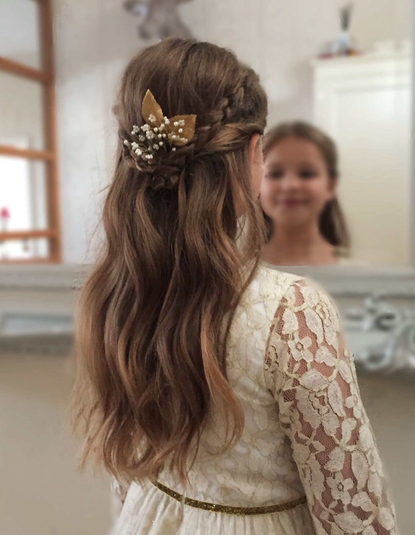 A simple braided half up, half down is perfect for this ...