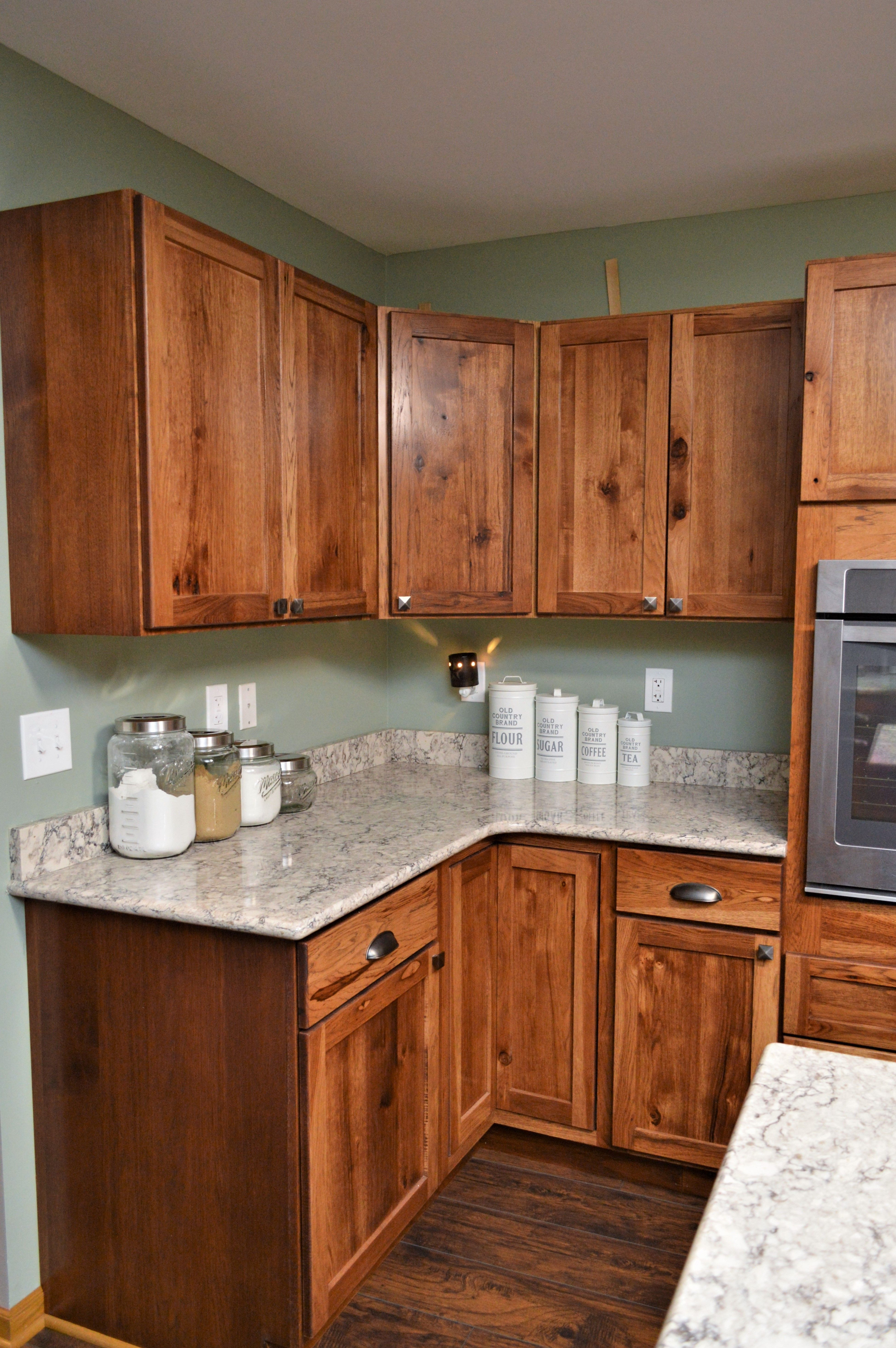 Bailey S Cabinets Haas Signature Collection Rustic Hickory Pecan Finish Shakertown V Door Style Rustic Kitchen Island Rustic Kitchen Hickory Cabinets