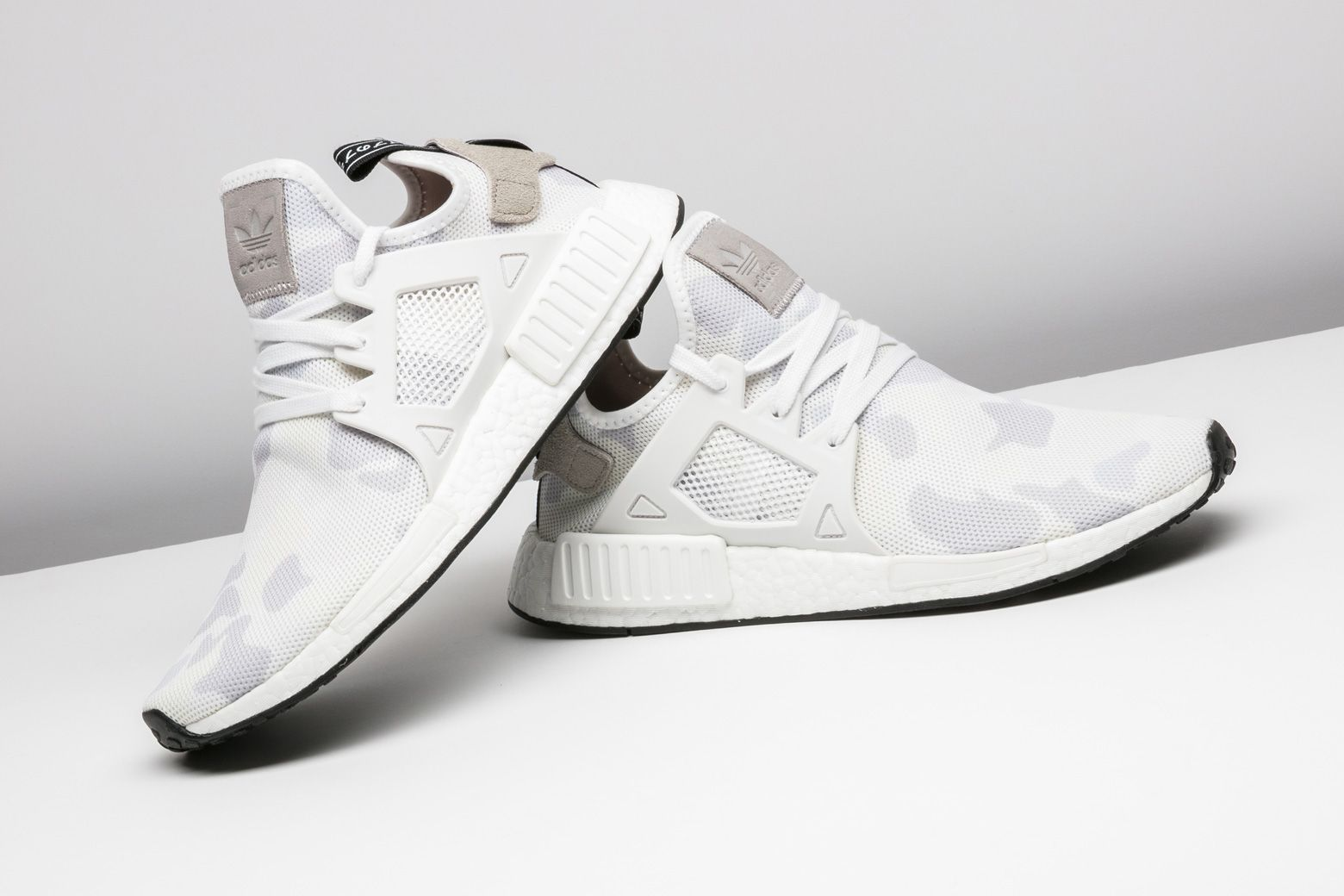 bfb73c76c White duck camo on the upper give this adidas NMD XR1 a clean look. http