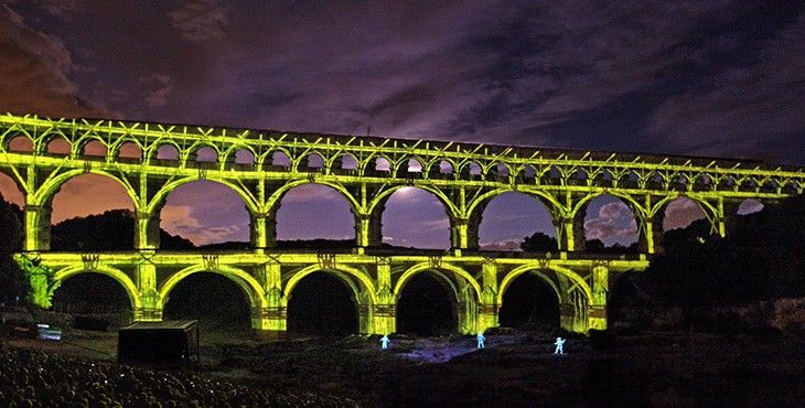 """""""Mirages"""" at Pont du Gard: Ancient Roman aqueduct bridge in France is transformed by light."""
