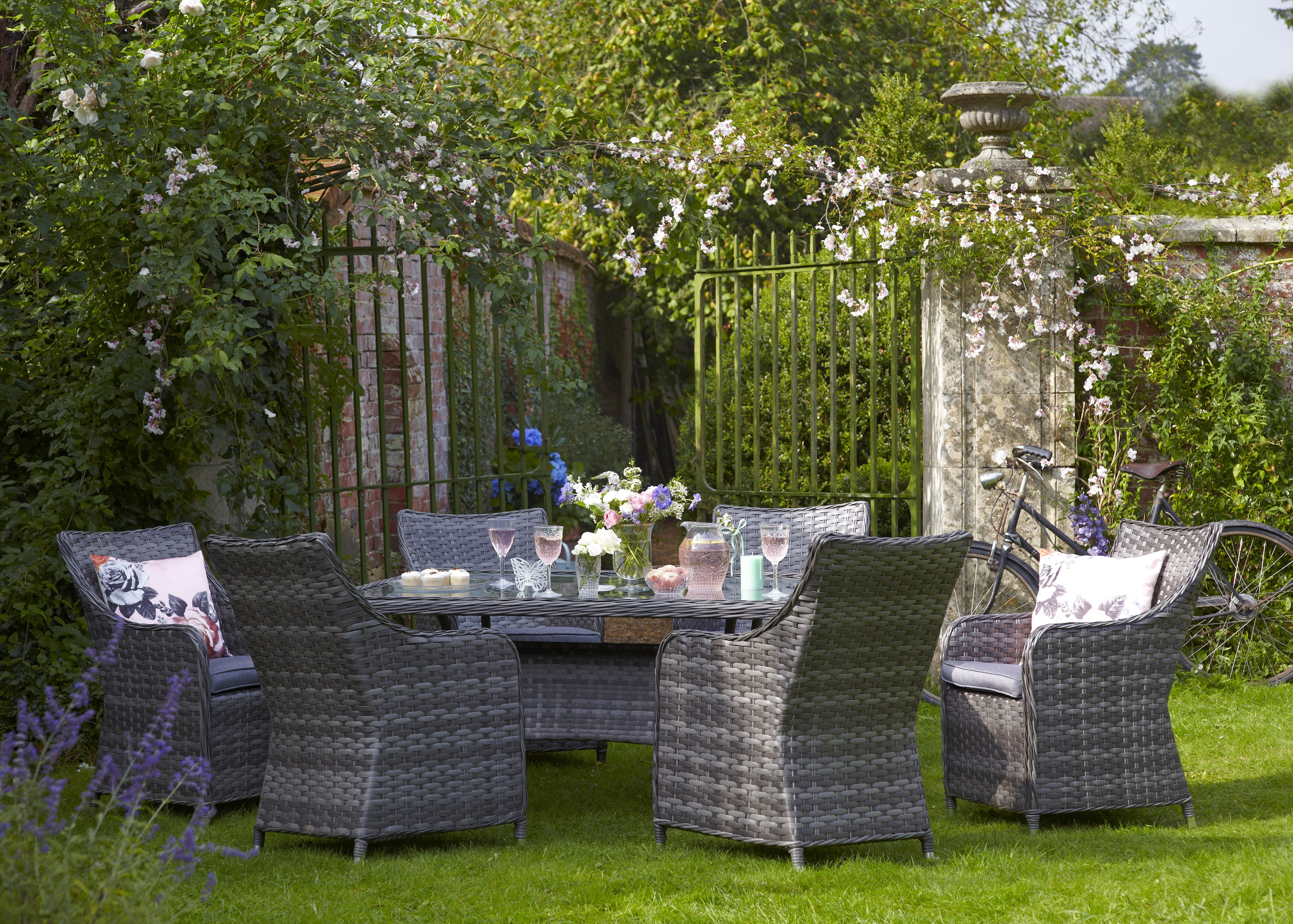 Captivating Beautiful Garden And Rattan Furniture. We Love How The Wall Climbers Have  Grown Around The