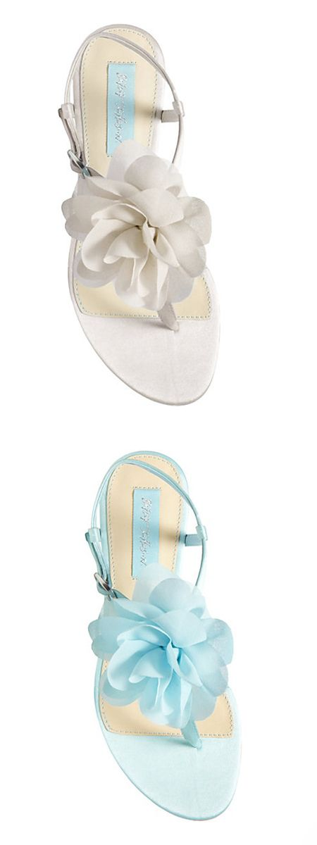 "Floaty petals compose a lovely bloom on a pretty satin thong sandal set on a signature ""something blue"" sole."