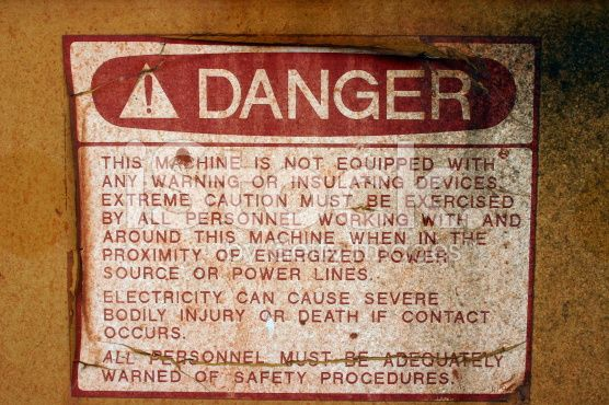Dirty Warning Sign - Electrocution royalty-free stock photo