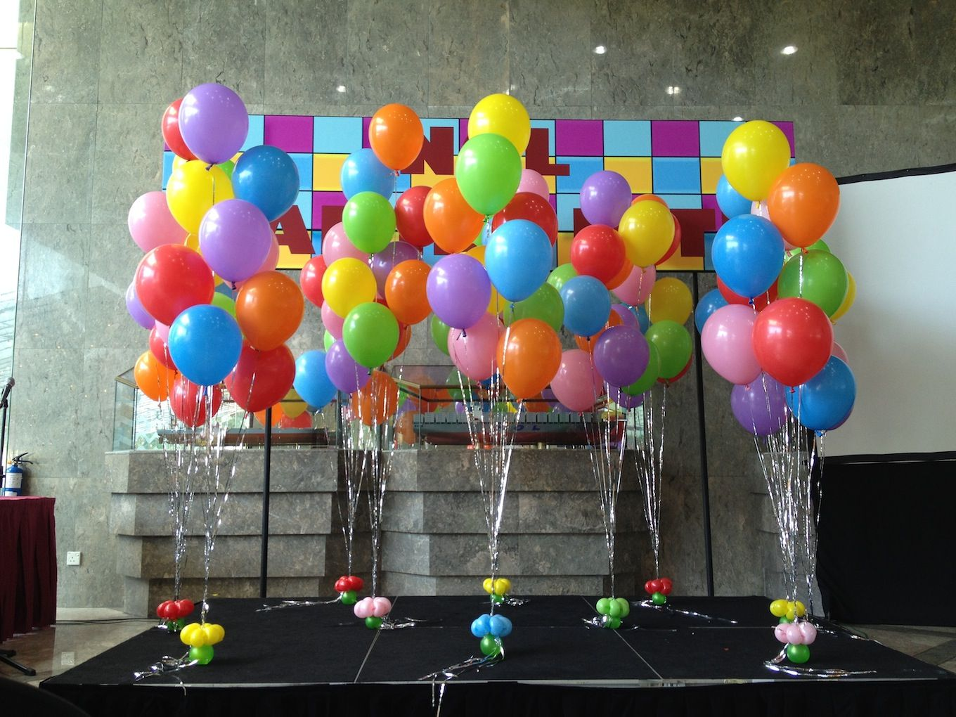 The Stage Decoration Includes A Customised Balloon Arch With Letters Star Columns And Few Bunches Of Helium Bouquet