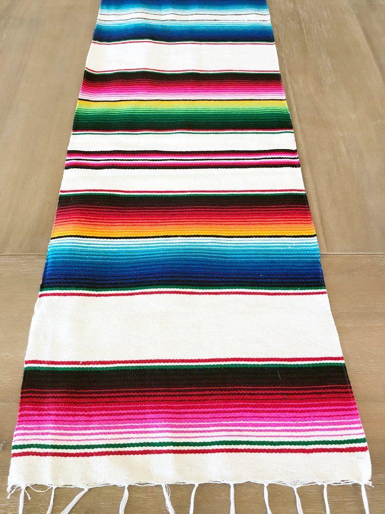e83d9076f74 Mexican Serape Table Runner White Colorful accents. Find this Pin and more on  MEXICAN FIESTA DECORATIONS by MesaChic Parties.