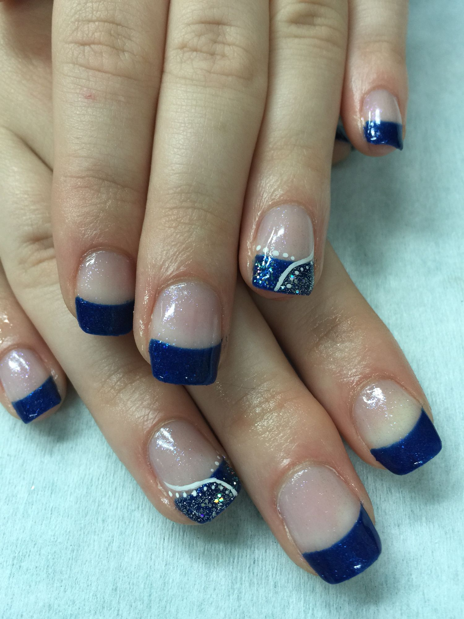 Royal blue French gel polish nails on an iridescent background with ...