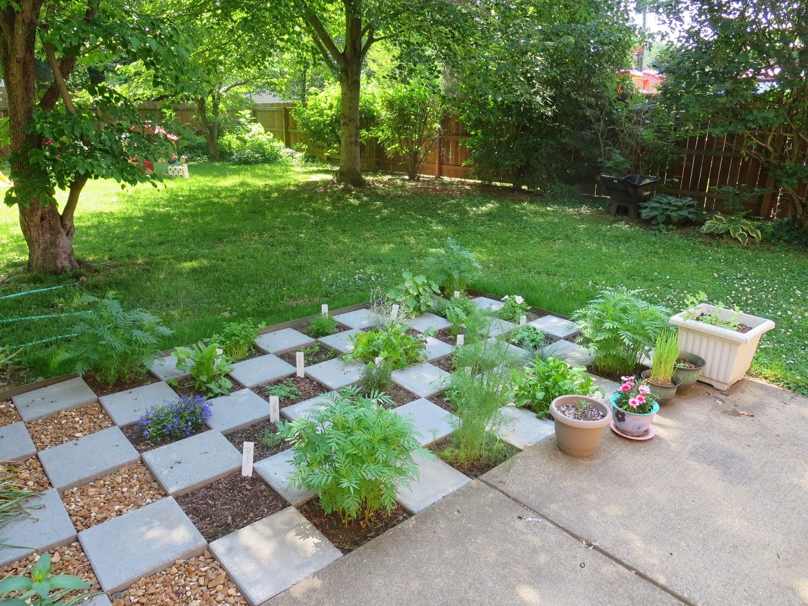 Checkerboard Herb Garden I have some of those pavers but I cant
