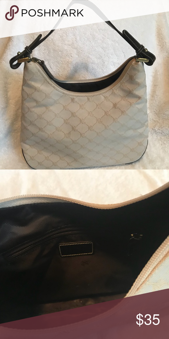 94f5611ae5 Ralph Lauren purse Like new! Cream colored Ralph Lauren purse. Short  leather strap for shoulder wear. One large pocket. Ralph Lauren Bags  Shoulder Bags