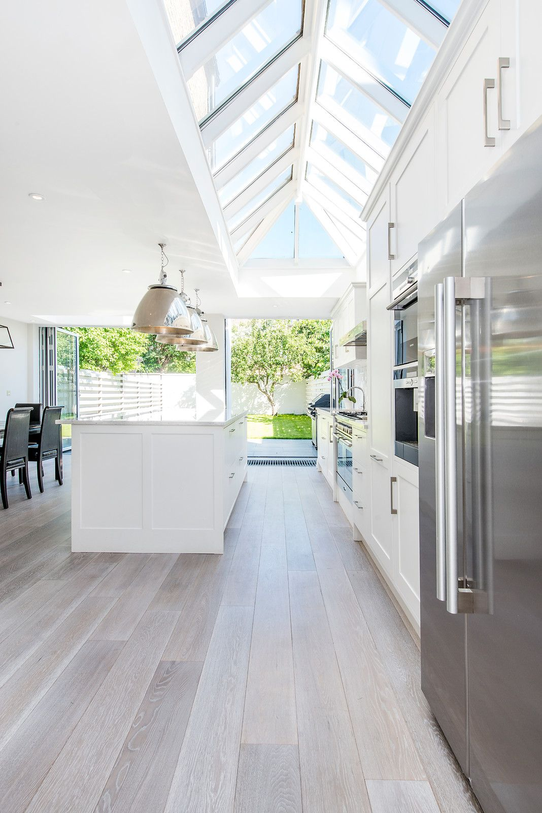 Transitional Galley Light Wood Floor Eat In Kitchen Photo In London With White Cabinets Shaker Cabinets Stainles White Wash Wood Floors White Oak Floors Home