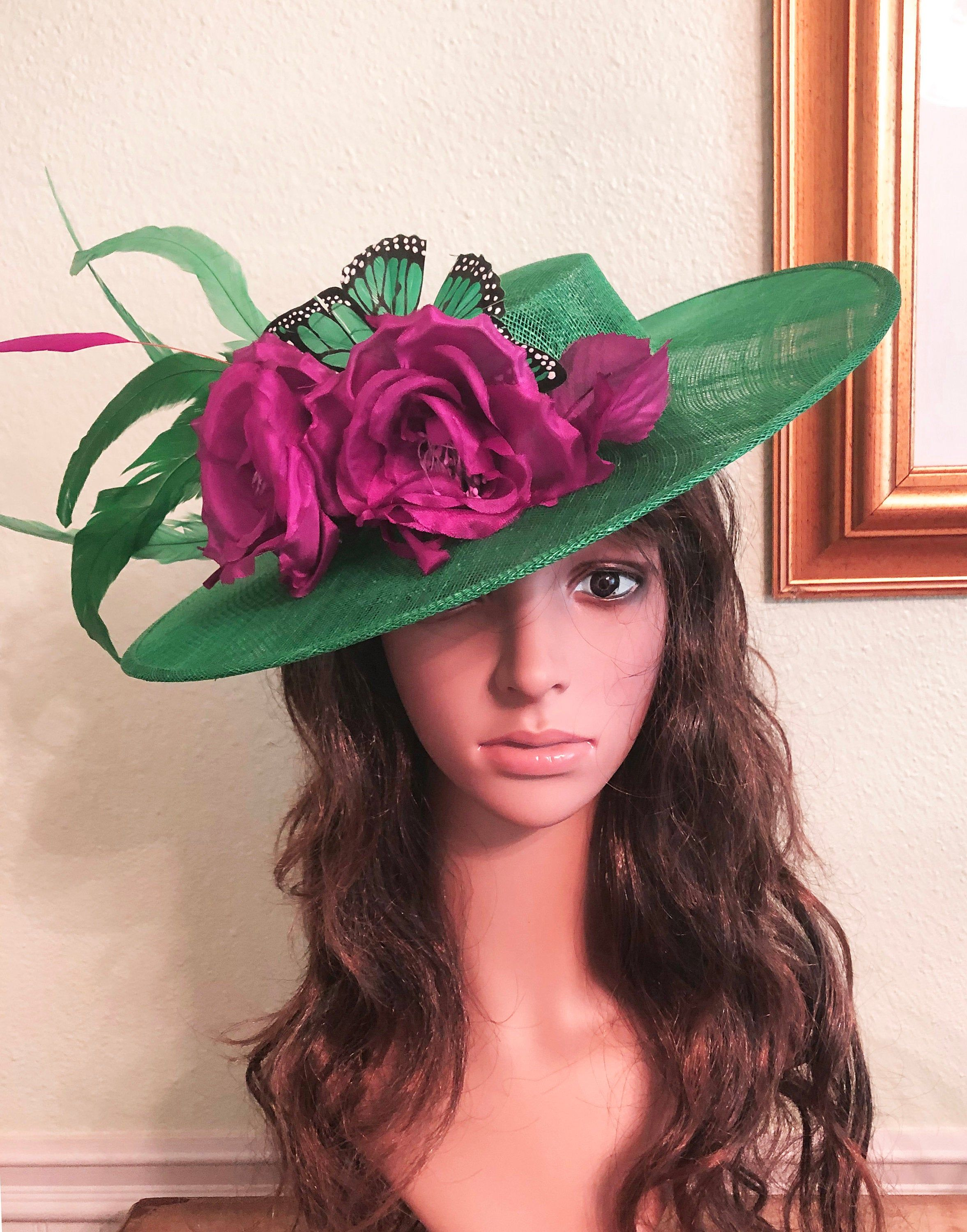 kentucky derby hat fascinator  black and white feathers cascade with fuchsia pink and black and blue green feather butterflies