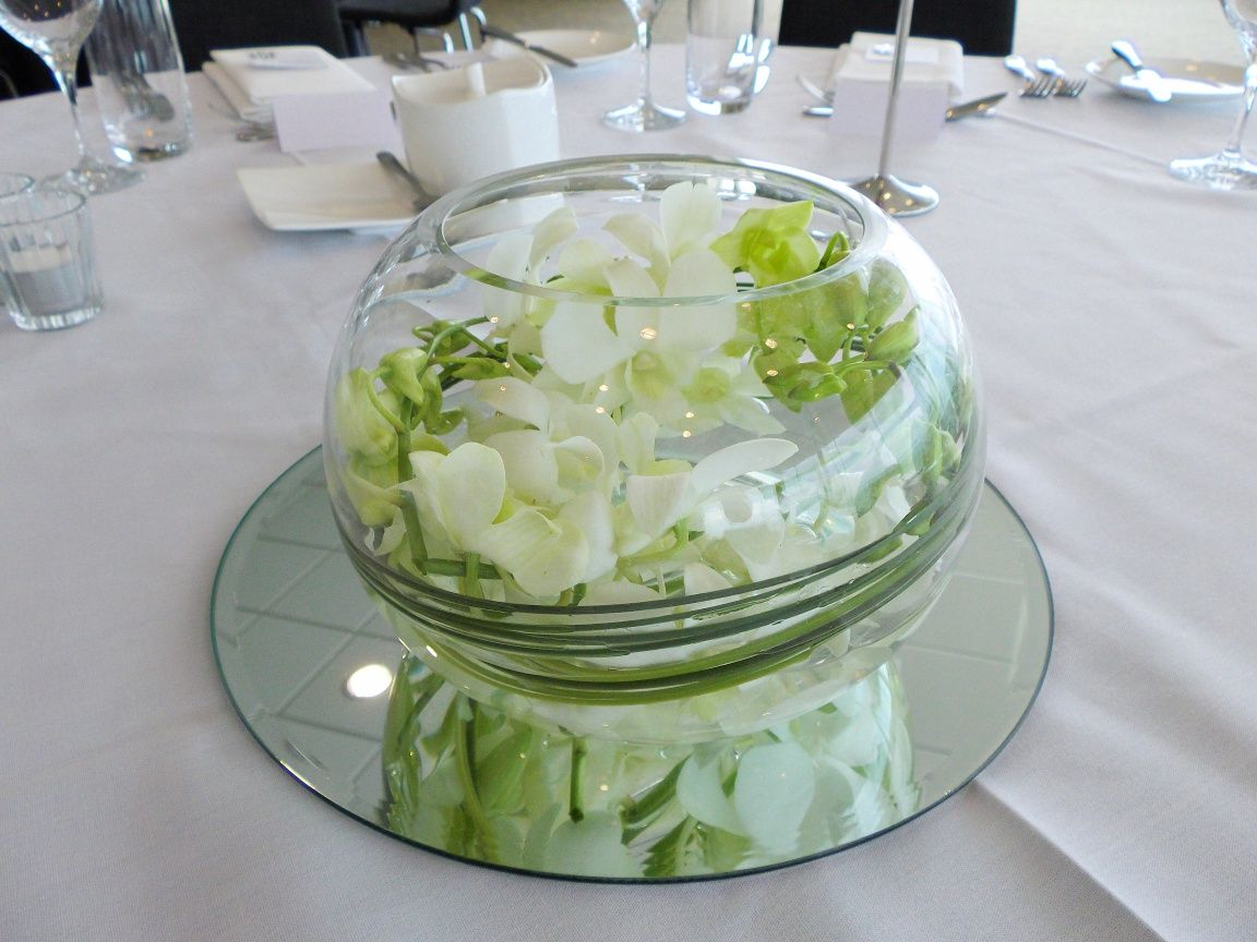 White orchid fishbowl table arrangement wedding bouquets