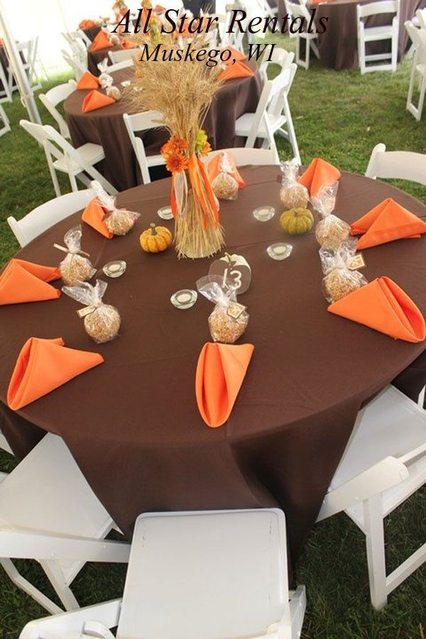 Two chocolate-brown table runners added depth to the burnt-orange ...