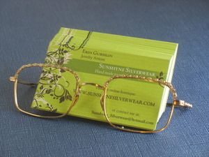 Card holder made from vintage glasses, this might be a cute idea