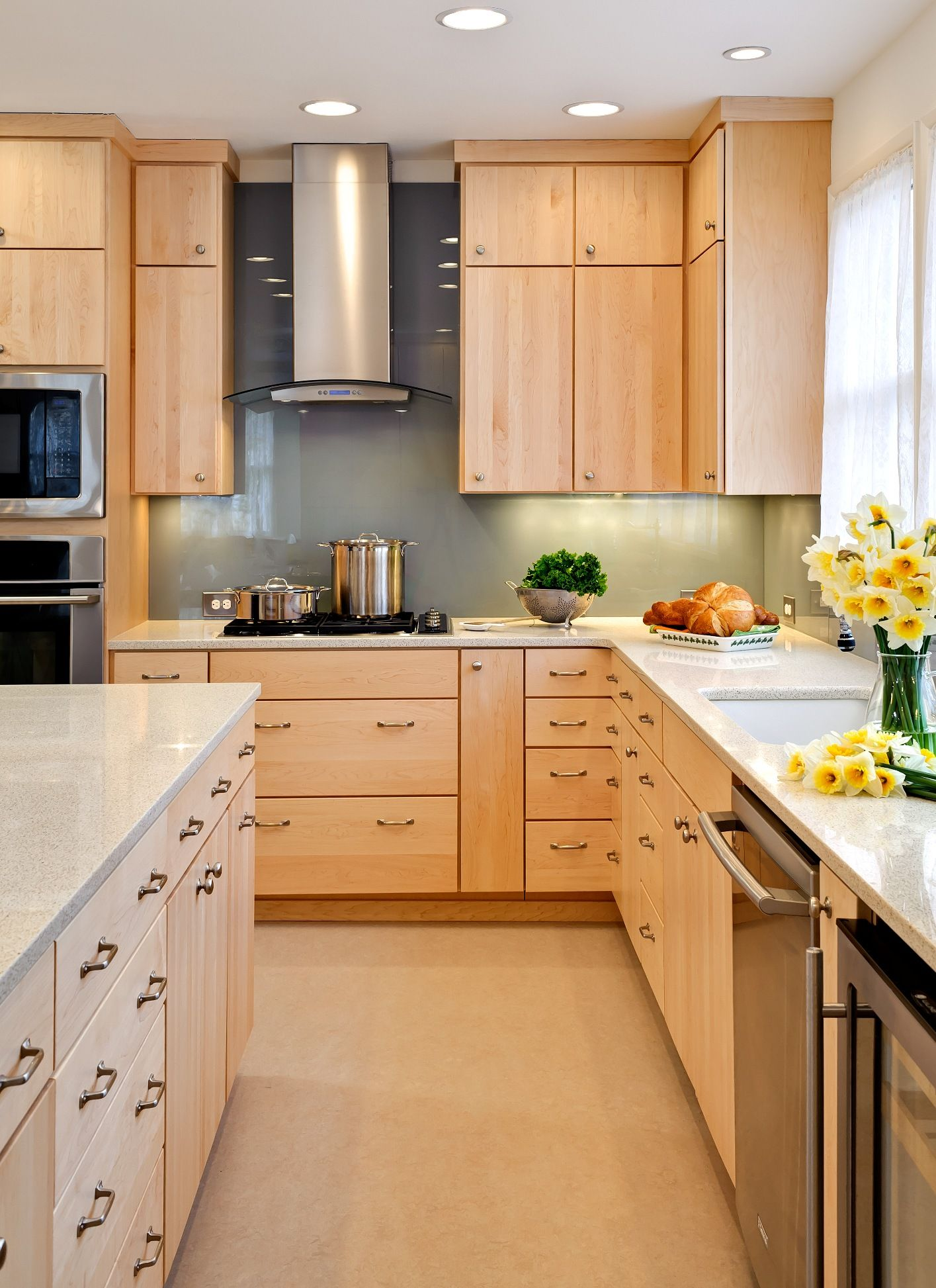 Natural maple cabinets light counters sage green walls kitchen